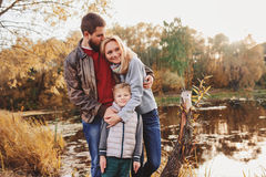 Happy family spending time together outdoor. Lifestyle capture, rural cozy scene. Father, mother and son walking in forest royalty free stock photography