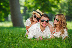 Happy family spends together the weekend. Young happy family of three having fun together outdoor. Pretty little daughter. Parents and girl look happy and smile Royalty Free Stock Photo