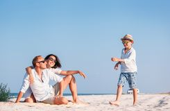 Happy family spent vacation time on the sea coast Stock Images