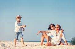 Happy family spent vacation time on the sea coast Stock Photo