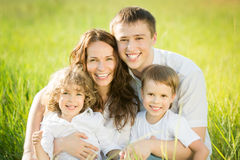 Happy family in spring field Stock Photography