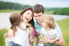 Happy family in spring field Royalty Free Stock Photography