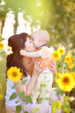 Happy family in spring field Royalty Free Stock Images