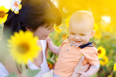 Happy family in spring field. Of beautiful sunflowers Stock Photos