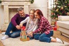 Happy family with christmas gifts royalty free stock photos