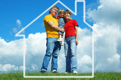 Happy family stand on green grass under sky. Happy family stand in house on green grass under sky with clouds Royalty Free Stock Photos