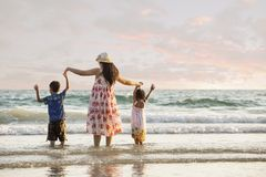 Happy family standing on the beach Stock Photography