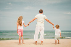 Happy family standing at the beach Royalty Free Stock Images