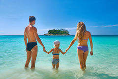 Happy family standing on the beach at the day time Royalty Free Stock Photography
