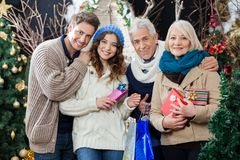 Happy Family Standing In Christmas Store Stock Photo