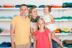 Happy Family Standing At Clothing Store Stock Photography