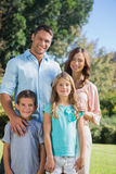 Happy family standing in the countryside Stock Photo