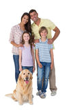 Happy family standing with dog Royalty Free Stock Image