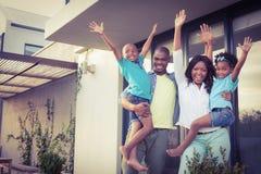 Happy family standing in the garden Stock Photos