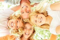 Happy family is standing head to head royalty free stock photography
