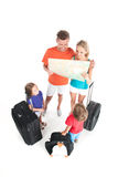 Happy family standing with luggage on white background. Stock Photo