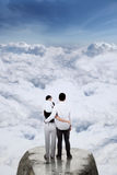 Happy family standing on the mountain Royalty Free Stock Photo