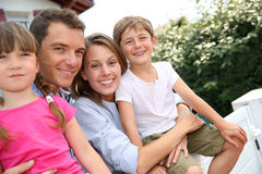 Happy family standing outside home Royalty Free Stock Image