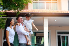 Happy family standing outside their new house, Real estate conce Stock Photography