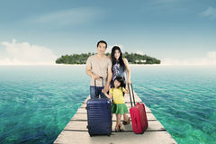 Happy family standing at resort bridge Stock Images