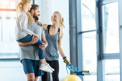 Happy family standing together at fitness center Royalty Free Stock Photography