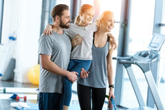 Happy family standing together at fitness center Stock Photos