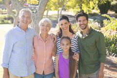 Happy family standing together in the park Royalty Free Stock Image