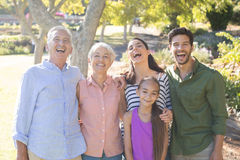 Happy family standing together in the park Royalty Free Stock Images