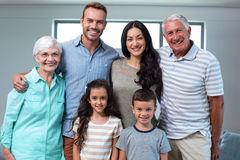 Happy family standing together and smiling Stock Image