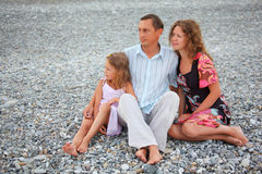Happy family on stone beach Stock Photo
