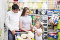 Happy family in the store Royalty Free Stock Images