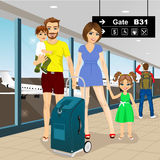 Happy family with suitcase in airport Stock Photo