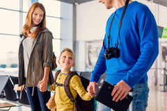 Happy family with suitcases in airport Stock Photography