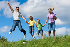 Happy family in summer stock images