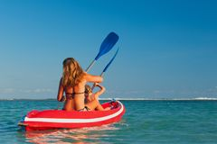 Happy family summer beach activity. Paddling on kayak. Royalty Free Stock Photo