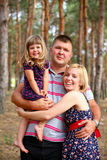 Happy family in the summer forest Stock Photography