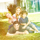 Happy family in summer in front of house Royalty Free Stock Images