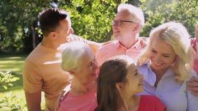 Happy family in summer garden stock video
