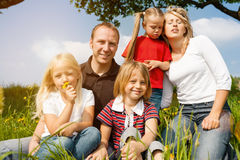 Happy family in summer on meadow Royalty Free Stock Images
