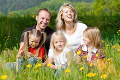 Happy family in summer on meadow Stock Photo