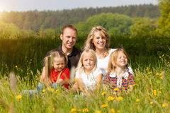 Happy family in summer on meadow Stock Photos