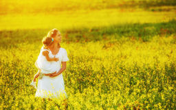 Happy family in summer meadow, mother and little daughter child Stock Photos