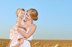 Happy family in summer nature. Mother and baby daughter in the w Stock Photo