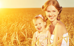Happy family in summer nature. Mother and baby daughter in the w Stock Photos