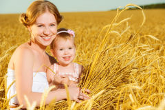 Happy family in summer nature. Mother and baby daughter in the w Royalty Free Stock Image