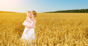 Happy family in summer nature. Mother and baby daughter in the w Royalty Free Stock Photo