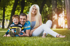 Happy family in the summer park Royalty Free Stock Photo