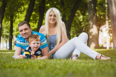 Happy family in the summer park Stock Photos