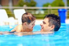 Happy family in summer pool. Happy family of father and son in summer pool Royalty Free Stock Photos