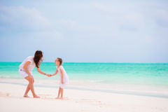 Happy family during summer vacation on white beach Stock Photos